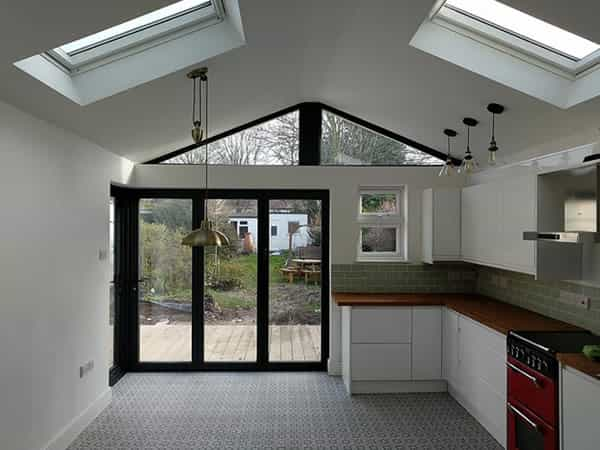 an image of a new and modern kitchen and a new bifolding door extention